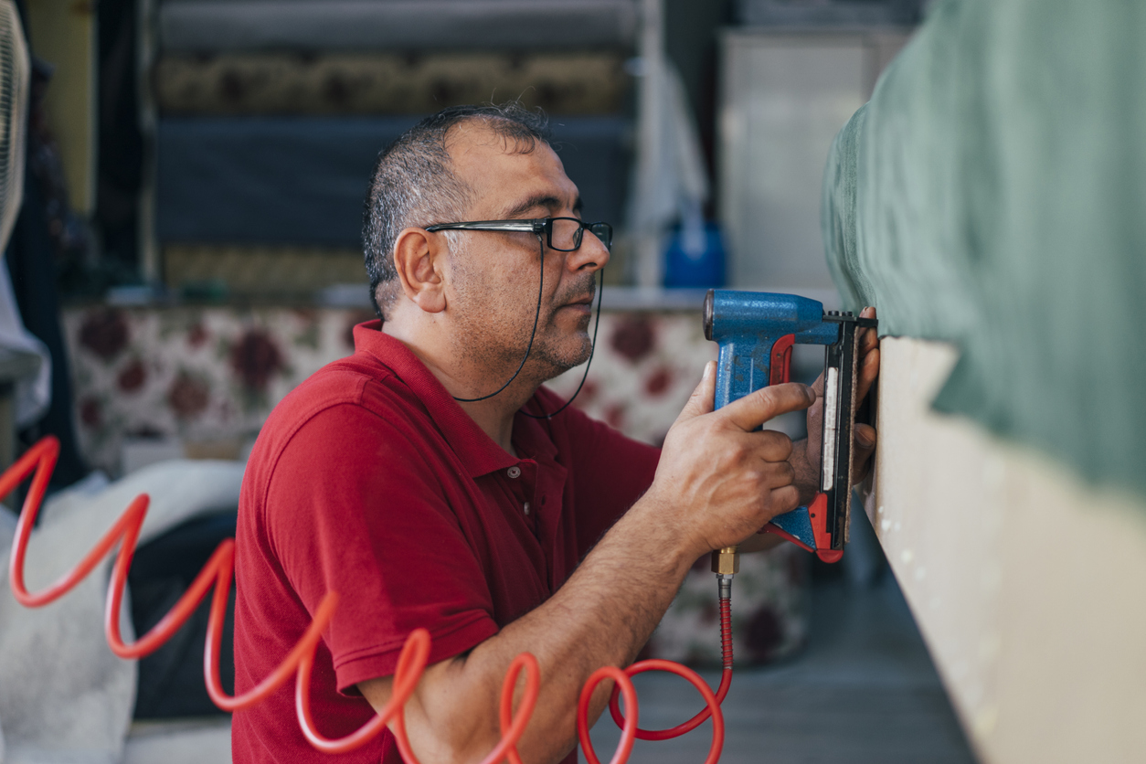 Factory Worker Upholstering Furniture Construction